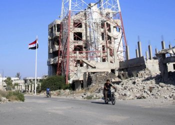 Syria's army entered rebel-held parts of Daraa city , state media said, raising the national flag in the cradle of the uprising that sparked the country's seven-year war./ (Mohamad Abazeed/AFP)