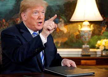 FILE PHOTO: U.S. President Donald Trump speaks to reporters after signing a proclamation declaring his intention to withdraw from the JCPOA Iran nuclear agreement in the Diplomatic Room at the White House in Washington, U.S. May 8, 2018. REUTERS/Jonathan Ernst/File Photo