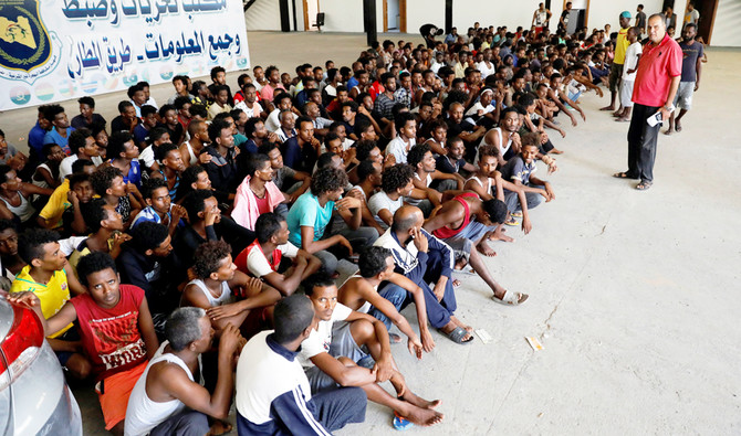 Migrants are seen in a shelter after they were relocated from government-run detention centers, after getting trapped by clashes between rival groups in Tripoli, Libya August 30, 2018. REUTERS/Hani Amara