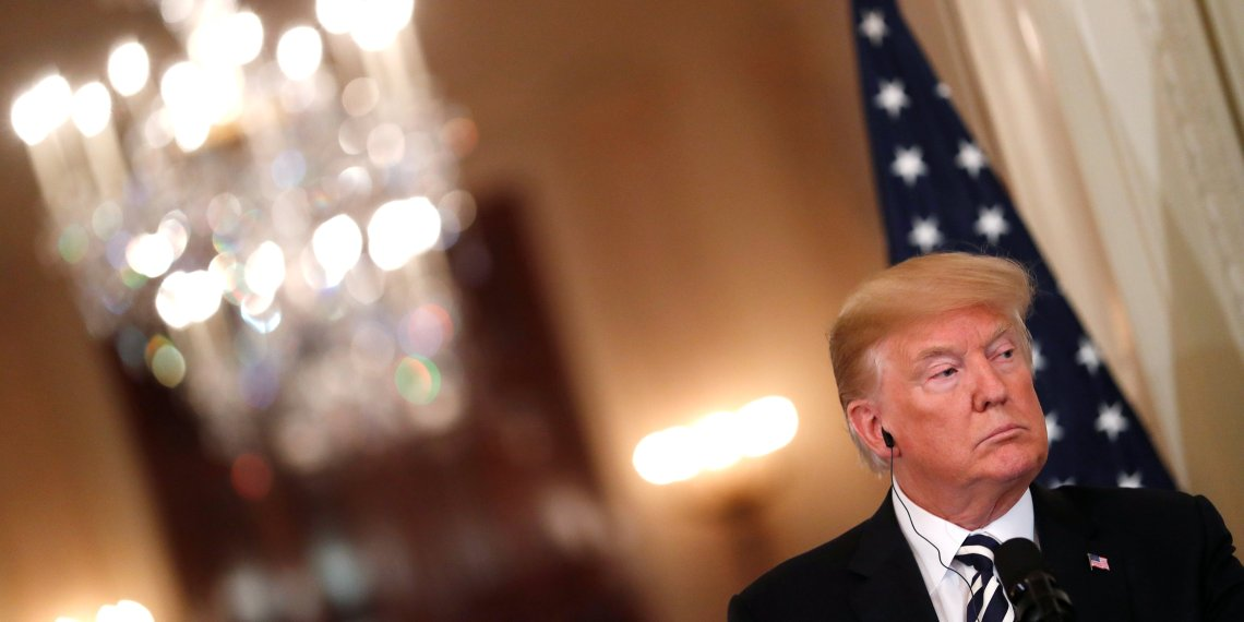 U.S. President Donald Trump listens to a question as he holds a joint news conference with Italy's Prime Minister Giuseppe Conte in the East Room of the White House in Washington, U.S., July 30, 2018. REUTERS/Carlos Barria