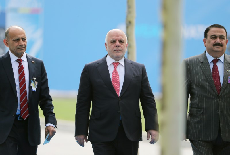 FILE PHOTO - Iraqi Prime Minister Haider al-Abadi arrives for the second day of a NATO summit in Brussels, Belgium, July 12, 2018. Tatyana Zenkovich/Pool via REUTERS