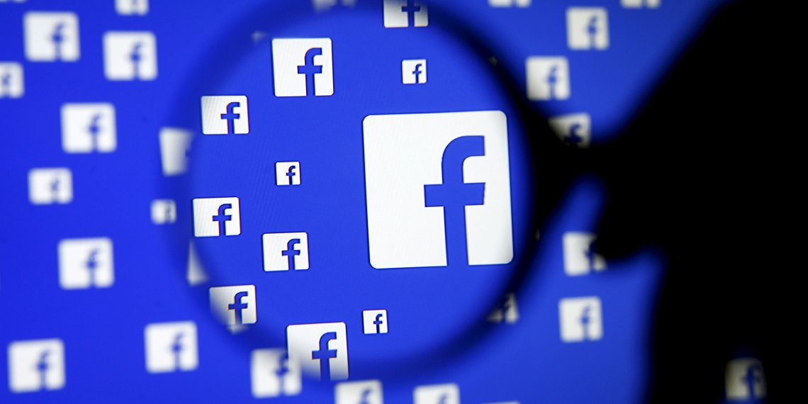 FILE PHOTO: A man poses with a magnifier in front of a Facebook logo on display in this illustration taken in Sarajevo, Bosnia and Herzegovina, December 16, 2015. REUTERS/Dado Ruvic/File Photo