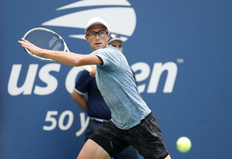 Aug 28, 2018; New York, NY, USA; Peter Polansky of Canada returns a shot against Alexander Zverev of Germany in a first round match on day two of the 2018 U.S. Open tennis tournament at USTA Billie Jean King National Tennis Center. Mandatory Credit: Jerry Lai-USA TODAY Sports