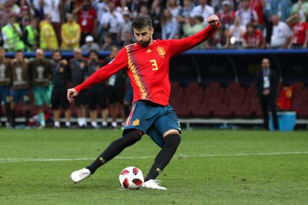 Soccer Football - World Cup - Round of 16 - Spain vs Russia - Luzhniki Stadium, Moscow, Russia - July 1, 2018 Spain's Gerard Pique scores a penalty during the shootout REUTERS/Albert Gea