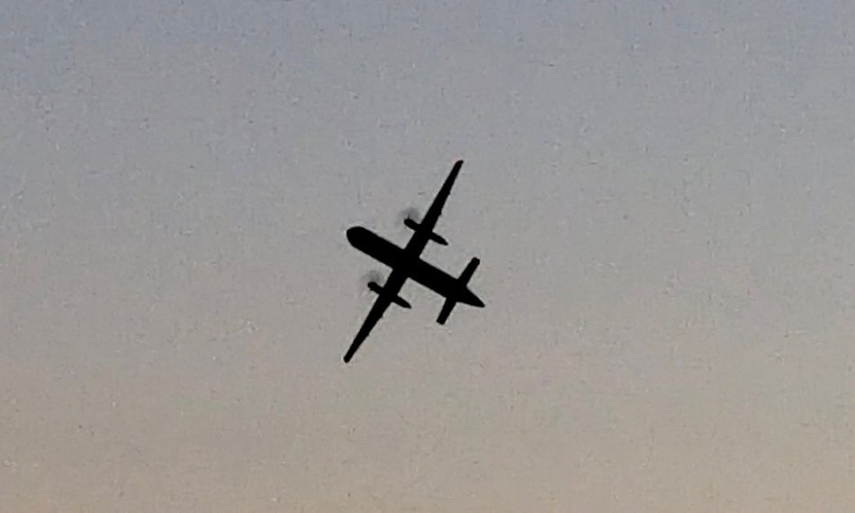 A Horizon Air Bombardier Dash 8 Q400, reported to be hijacked, flies over University Place, Washington, the U.S., before crashing in the South Puget Sound, August 10, 2018 in this still image taken from a video obtained from social media. John Waldron/via REUTERS