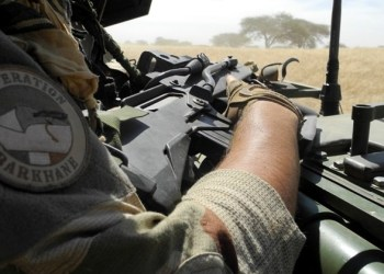 n this file photo taken on November 1, 2017 shows a soldier of France's Barkhane force bearing holding a Famas assault rifle as he patrols in central Mali, at the border zone with Burkina Faso and Niger. One of the main leaders of the Islamic State in the Greater Sahara (ISGS) jihadist group, Mohamed Ag Almouner, and two civilians were killed on August 26, 2018, in a French military operation in the Menaka region in northern Mali, a French army communique said on August 27, 2018. The overnight