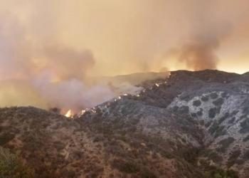 The Holy Fire spreads in Lake Elsinore, California, the U.S. August 8, 2018 in this still image taken from a video obtained from social media. Lake Elsinore City Hall/via REUTERS