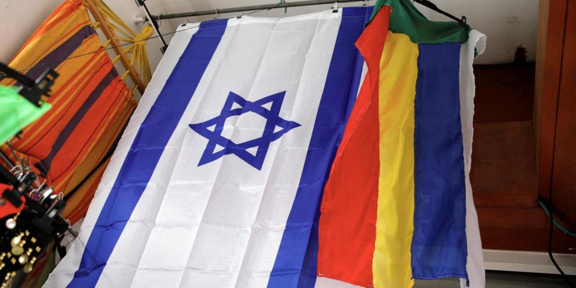An Israeli and a Druze flag hang from the ceiling of a store in the Druze town of Daliat al-Karmel, northern Israel August 2, 2018. REUTERS/Amir Cohen
