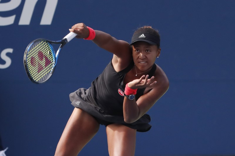 Sep 1, 2018; New York, NY, USA; Naomi Osaka of Japan serves against Aliaksandra Sasnovich of Belarus (not pictured) in the third round on day six of the US Open at USTA Billie Jean King National Tennis Center. Mandatory Credit: Geoff Burke-USA TODAY Sports