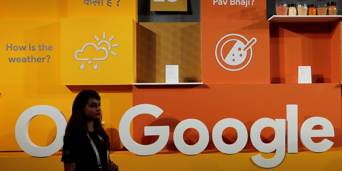 A woman walks past the logo of Google during an event in New Delhi, India, August 28, 2018. REUTERS/Adnan Abidi