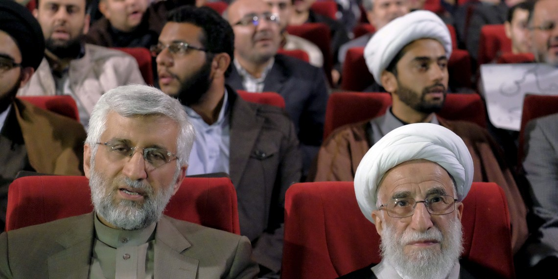 """FILE PHOTO: Ayatollah Ahmad Jannati (R), a candidate for the upcoming vote on the Assembly of Experts, and Iran's former chief negotiator Saeed Jalili attend a conservatives election campaign gathering in Tehran February 24, 2016. The campaign gathering was titled """"No to UK Meddling"""". REUTERS/Raheb Homavandi/TIMA"""
