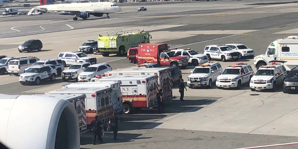 FILE PHOTO: The emergency services are seen, after the passengers were taken ill on a flight from New York to Dubai, on JFK Airport, New York, U.S., September 05, 2018 in this still image obtained from social media.   Larry Coben/via REUTERS