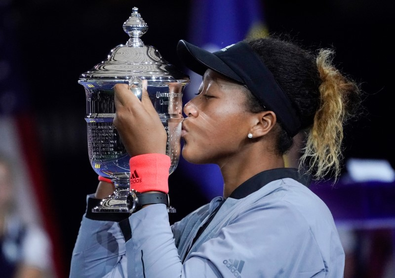 Sept 8, 2018; New York, NY, USA; Naomi Osaka of Japan kisses the U.S. Open trophy after beating Serena Williams of the USA in the women's final on day thirteen of the 2018 U.S. Open tennis tournament at USTA Billie Jean King National Tennis Center. Mandatory Credit: Robert Deutsch-USA TODAY Sports
