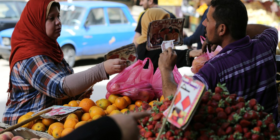 FILE PHOTO: An Egyptian woman shops at a vegetable market in Cairo, Egypt May 10, 2016. REUTERS/Mohamed Abd El Ghany