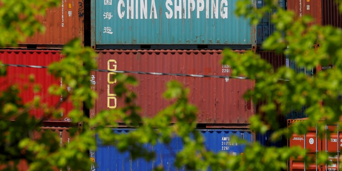 "FILE PHOTO: Shipping containers, including one labelled ""China Shipping,"" are stacked at the Paul W. Conley Container Terminal in Boston, Massachusetts, U.S., May 9, 2018.   REUTERS/Brian Snyder/File Photo"