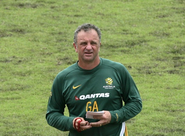 Australia's national soccer team head coach Graham Arnold walks on the pitch during a team practice session at the 2007 AFC Asian Cup tournament in Bangkok July 12, 2007.  REUTERS/Chaiwat Subprasom  (THAILAND)
