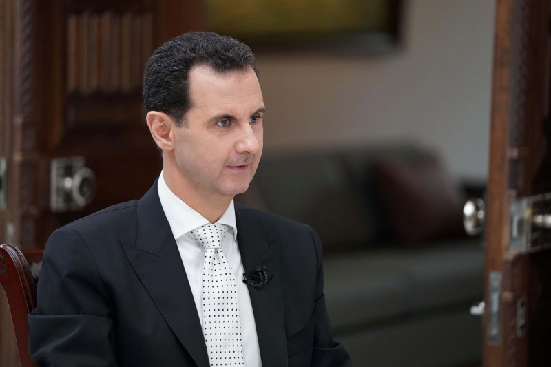 FILE PHOTO: Syria's President Bashar al Assad attends an interview with a Greek newspaper in Damascus, Syria in this handout released May 10, 2018. SANA/Handout via Reuters