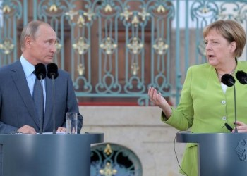 FILE PHOTO: German Chancellor Angela Merkel speaks next to Russian President Vladimir Putin at the German government guest house Meseberg Palace in Gransee, Germany August 18, 2018. Sputnik/Alexei Druzhinin/Kremlin via REUTERS