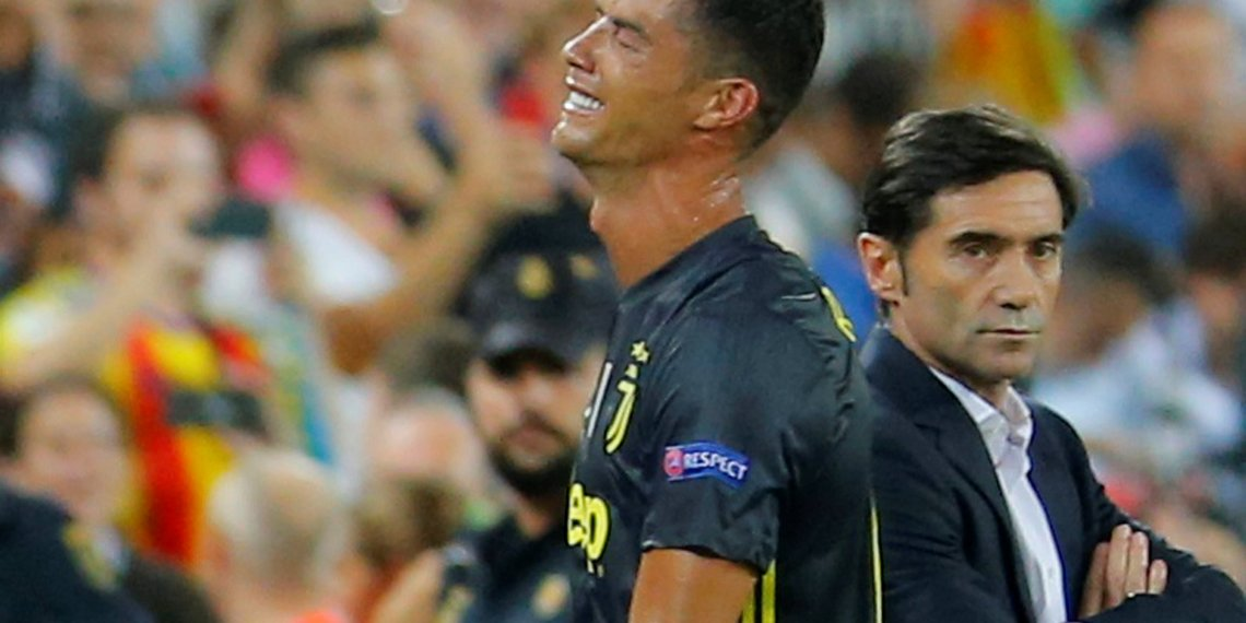 Soccer Football - Champions League - Group Stage - Group H - Valencia v Juventus - Mestalla, Valencia, Spain - September 19, 2018 Juventus' Cristiano Ronaldo reacts after he is sent off while Valencia coach Marcelino Garcia looks on REUTERS/Heino Kalis