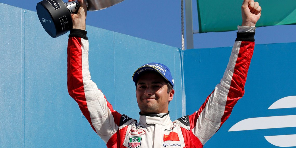 FILE PHOTO: Nelson Piquet Junior celebrates with his second place trophy after round three of the Formula E championship in Punta del Este, December 13, 2014. REUTERS/Andres Stapff/File Photo