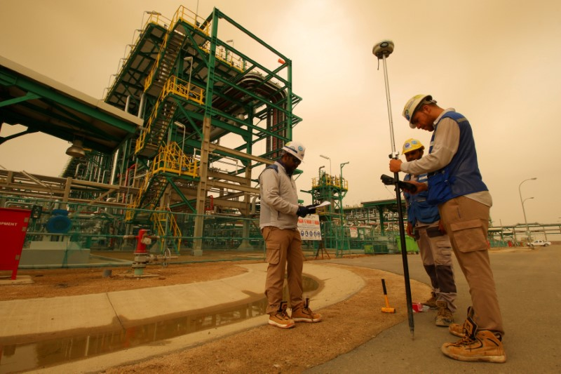 FILE PHOTO: Workers are seen at the Zubair oilfield in Basra, Iraq May 9, 2018. REUTERS/Essam al-Sudani/File Photo
