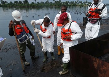 Members of the joint task force, part of the Bodo oil spill clean-up operation, inspect the site of an illegal refinery near the village of Bodo in the Niger Delta, Nigeria August 2, 2018. REUTERS/Ron Bousso