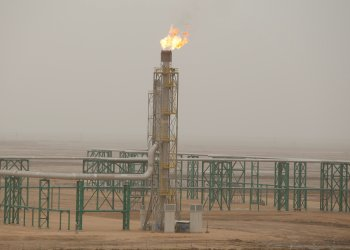 FILE PHOTO: Excess gas is burnt off at a pipeline at the Zubair oilfield in Basra, Iraq, May 9, 2018. REUTERS/Essam al-Sudani/File Photo