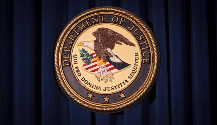 FILE PHOTO: The Department of Justice (DOJ) logo is pictured on a wall after a news conference in New York December 5, 2013. REUTERS/Carlo Allegri/File Photo