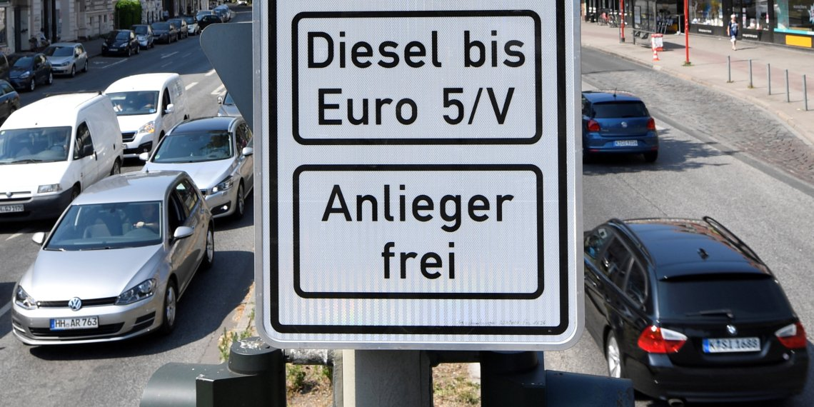 FILE PHOTO: A traffic sign, which ban diesel cars is pictured at the Max-Brauer Allee in downtown Hamburg, Germany, May 31, 2018. REUTERS/Fabian Bimmer/File Photo