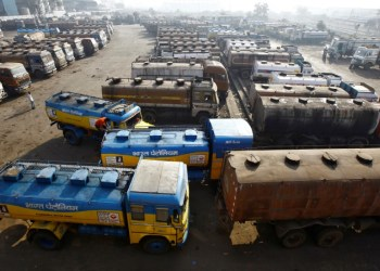 FILE PHOTO: Oil tankers are seen parked at a yard outside a fuel depot on the outskirts of Kolkata February 3, 2015. REUTERS/Rupak De Chowdhuri/File Photo