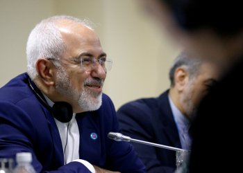 FILE PHOTO: Iran's Foreign Minister Mohammad Javad Zarif smiles as he attends a bilateral meeting with China's Foreign Minister Wang Yi on the sidelines of the ASEAN Foreign Ministers' Meeting in Singapore, August 3, 2018. REUTERS/Feline Lim/File Photo