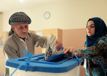 A Kurdish man casts his vote at a polling station during parliamentary elections in the semi-autonomous region in Duhok, Iraq September 30, 2018. REUTERS/Ari Jalal