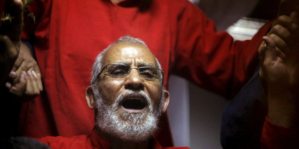 FILE PHOTO: Muslim Brotherhood's Supreme Guide Mohamed Badie (C) reacts with other brotherhood members at a court in the outskirts of Cairo, Egypt May 16, 2015. REUTERS/Mohamed Abd El Ghany/File Photo