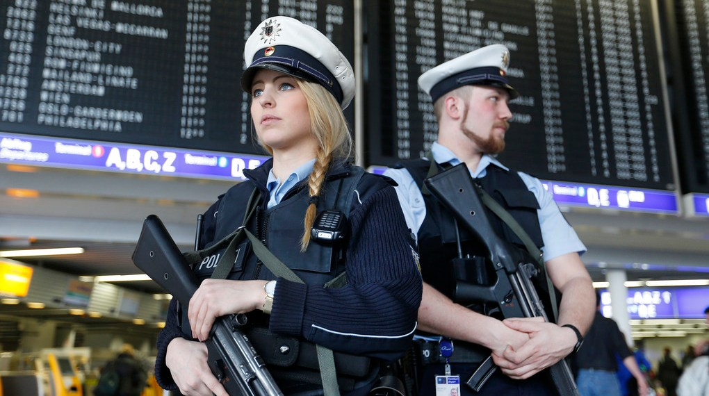 German police officers guard  a terminal of the airportthe  in Frankfurt, Germany, during tighter security measures  Tuesday, March 22, 2016, when various explosions hit the the Belgian capital  Brussels killing several people. (AP Photo/Michael Probst)