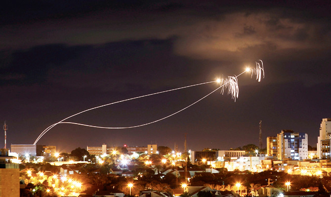 Iron Dome anti-missile system fires interception missiles as rockets are launched from Gaza towards Israel as seen from the city of Ashkelon, Israel October 27, 2018. (REUTERS)