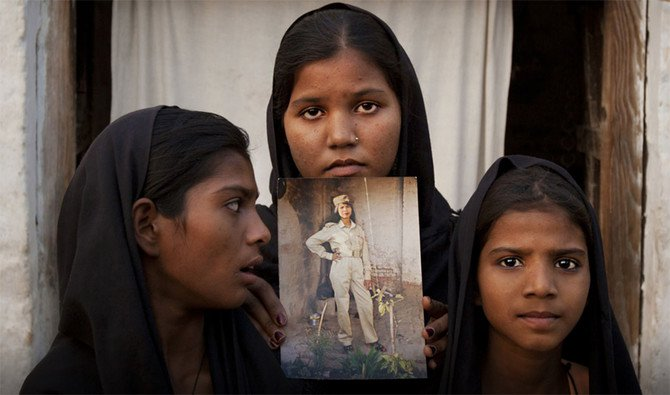 The daughters of Pakistani Christian woman Aasia Bibi pose with an image of their mother. Pakistan's top court is set to announce on Wednesday a final verdict on Aasia Bibi who has been sentenced to death in 2010 on blasphemy charges. (Reuters)