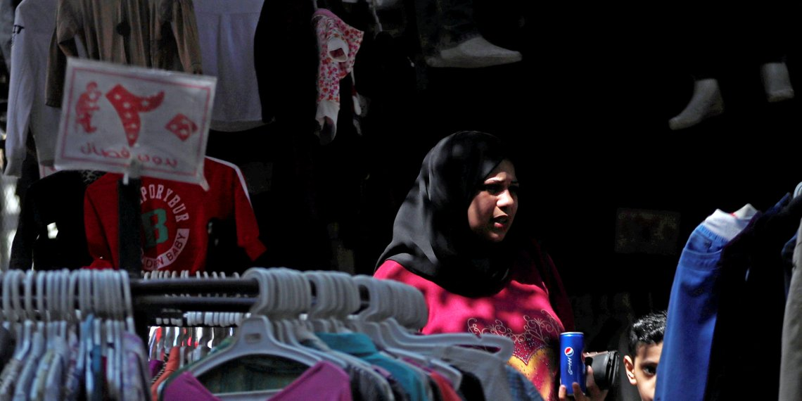 A woman and her son look on at a clothes market in Cairo, Egypt, September 13, 2018. REUTERS/Amr Abdallah Dalsh