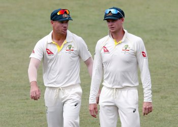 FILE PHOTO: Cricket - South Africa vs Australia - First Test Match - Kingsmead Stadium, Durban, South Africa - March 5, 2018. Australia's David Warner and Steve Smith leave the pitch after beating South Africa. REUTERS/Rogan Ward