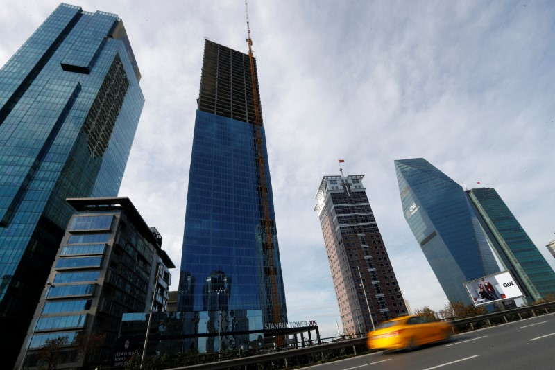 FILE PHOTO: Skyscrapers are seen in the business and financial district of Levent, which comprises of leading Turkish banks' and companies' headquarters, in Istanbul, Turkey, November 30, 2017. REUTERS/Murad Sezer