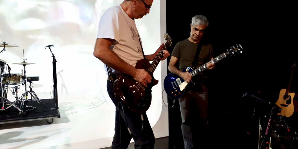 "FILE PHOTO: British actor David Jackson (L) and Argentine actor Gabriel Sagastume play guitars during a rehearsal of the theatre play ""Campo Minado"" (Minefield) in Buenos Aires, Argentina September 28, 2018. REUTERS/Lucila Sigal/File photo"