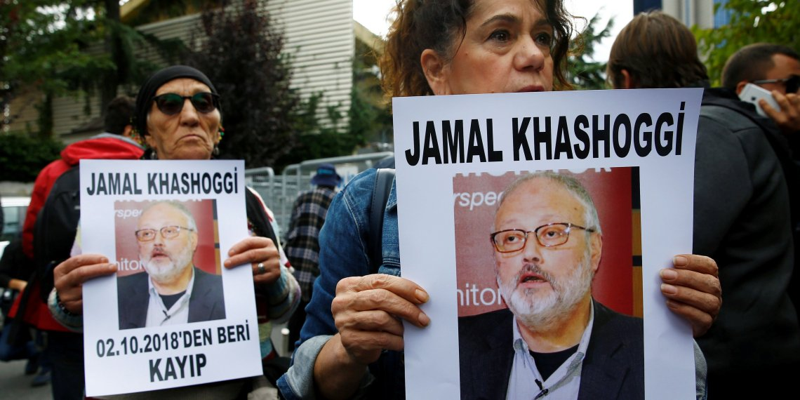 Human rights activists hold pictures of Saudi journalist Jamal Khashoggi during a protest outside the Saudi Consulate in Istanbul, Turkey October 9, 2018. REUTERS/Osman Orsal