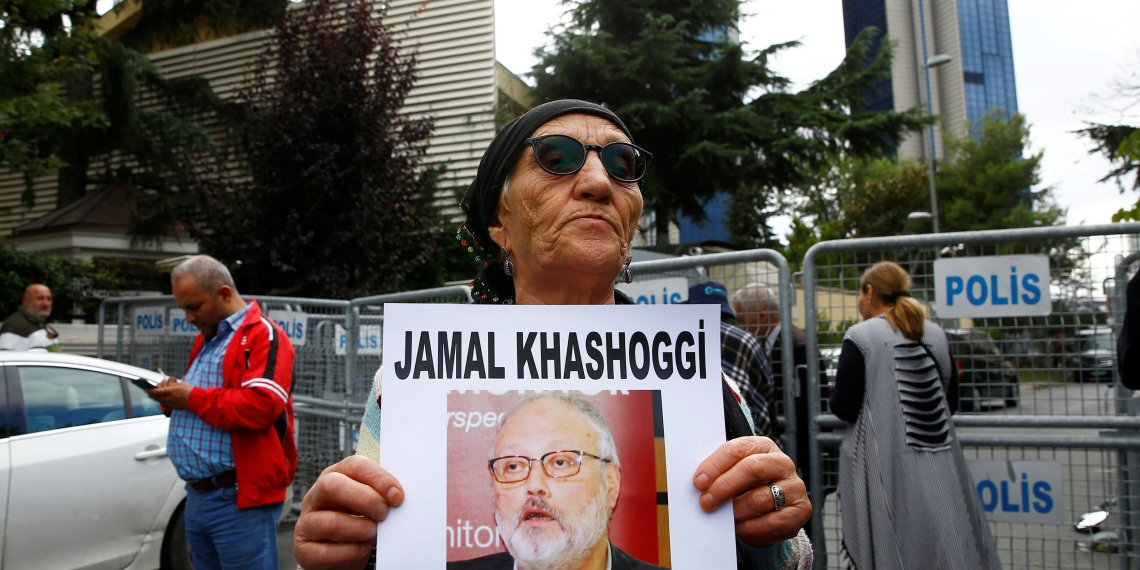 A human rights activist holds picture of Saudi journalist Jamal Khashoggi during a protest outside the Saudi Consulate in Istanbul, Turkey October 9, 2018. REUTERS/Osman Orsal
