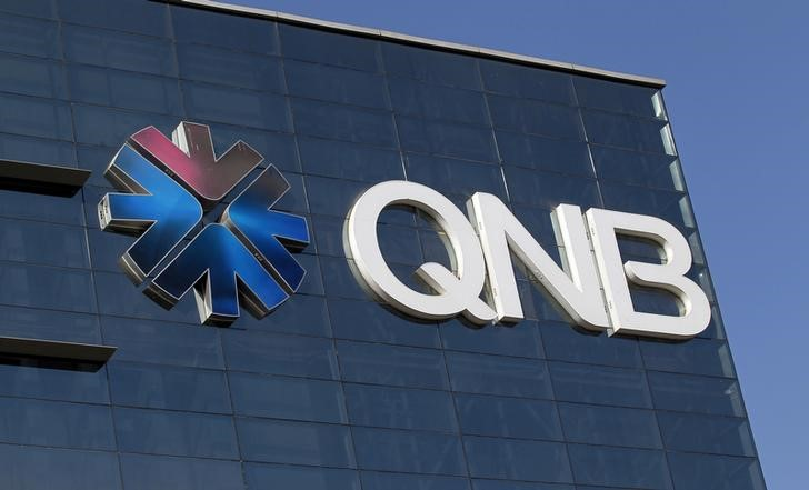 FILE PHOTO - The logo of Qatar National Bank is seen on its building in Doha, Qatar January 16, 2018. REUTERS/Stringer