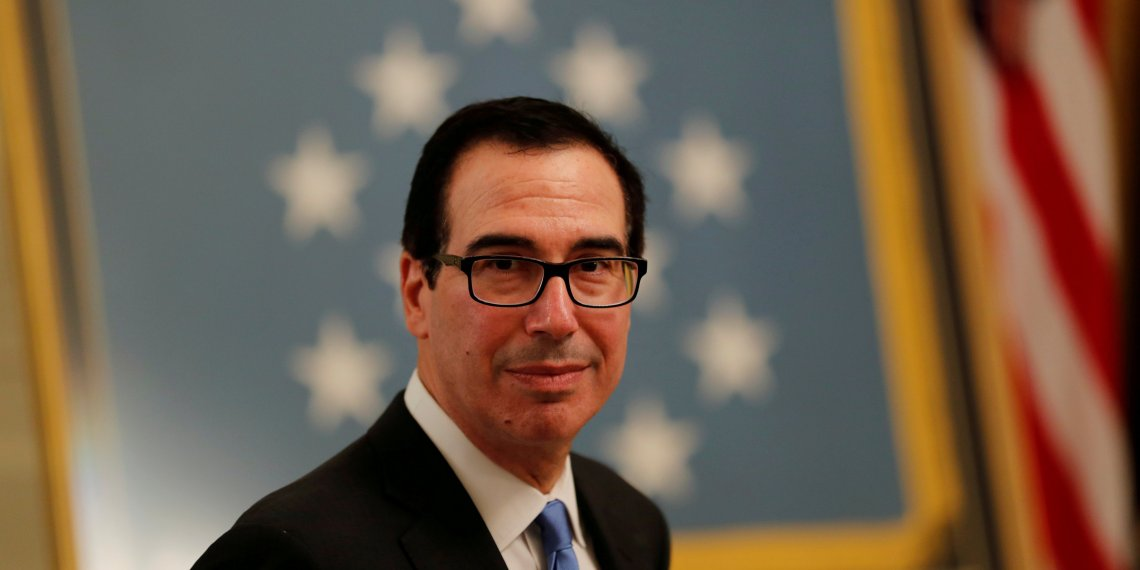 FILE PHOTO: U.S. Treasury Secretary Steven Mnuchin arrives at a White House reception for Congressional Medal of Honor recipients in the East Room of the White in Washington, U.S., September 12, 2018. REUTERS/Carlos Barria