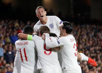 Soccer Football - UEFA Nations League - League A - Group 4 - Spain v England - Estadio Benito Villamarin, Seville, Spain - October 15, 2018 England's Raheem Sterling (hidden) celebrates with team mates after scoring their first goal Action Images via Reuters/Carl Recine