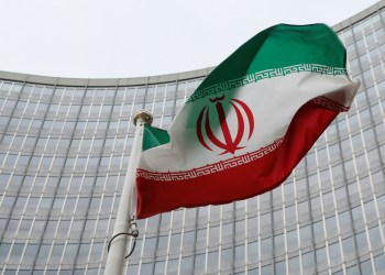 FILE PHOTO: An Iranian flag flutters in front of the International Atomic Energy Agency (IAEA) headquarters in Vienna, Austria, January 15, 2016. REUTERS/Leonhard Foeger