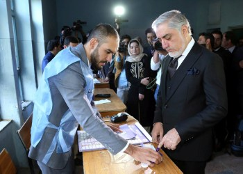 Afghanistan's Chief Executive Abdullah Abdullah arrives to cast his vote during parliamentary election at a polling station in Kabul, Afghanistan, October 20, 2018. Chief Executive Office/Handout via REUTERS