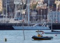 An inflatable passes the semi-submerged mast of a yacht that sank after colliding with the Red Falcon Ferry, near the entrance to Cowes Harbour, the Isle of Wight, Britain October 21, 2018. REUTERS/Peter Nicholls