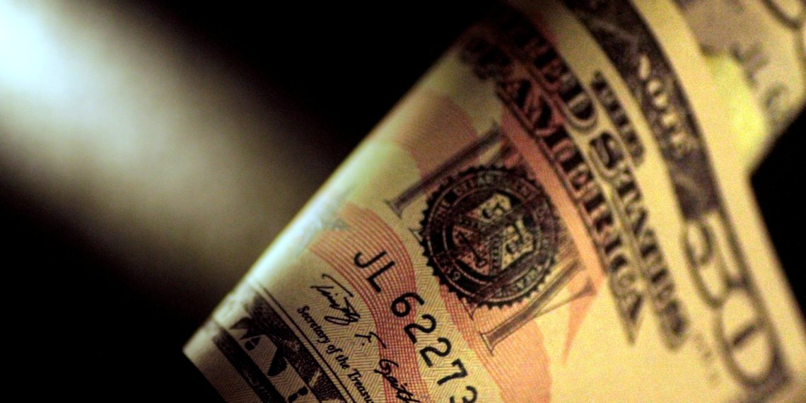 FILE PHOTO: A U.S. Dollar note is seen in this June 22, 2017 illustration photo. REUTERS/Thomas White/Illustration