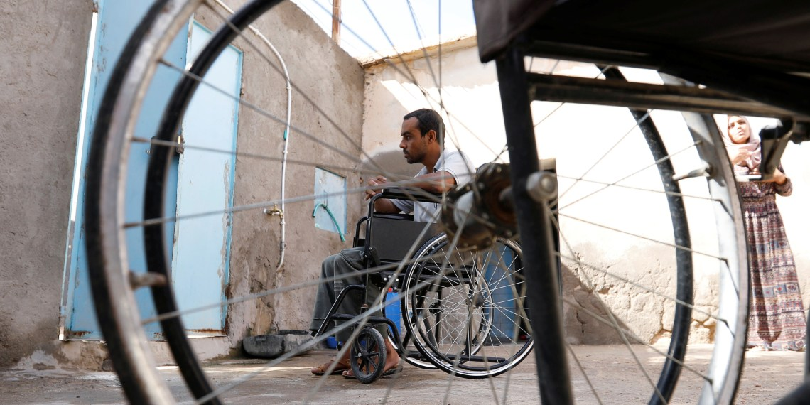 FILE PHOTO: Hamid, 28, an unemployed member of a family of six disabled people, sits on a wheelchair at his house in Remada town south Tunisia, October 12, 2018. REUTERS/Zoubeir Souissi
